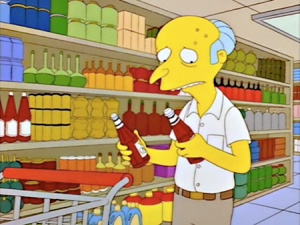 """ABOVE: David Brooks, forced to do his own grocery shopping, uses his copious mental equipment to ponder the """"ketchup v. catsup"""" dilemma."""